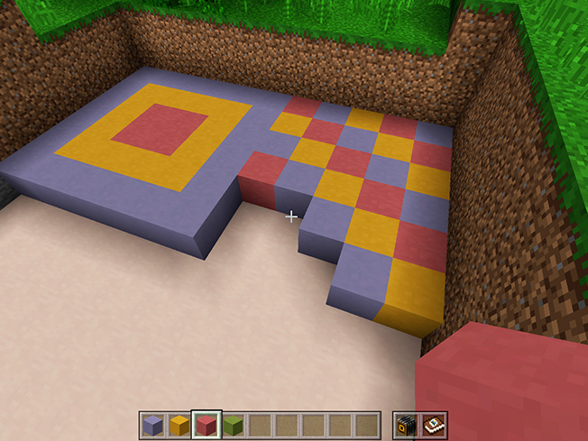 Screenshot an in-game experience of creating patterns with Minecraft blocks.